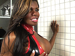 Red and black latex clad shemale