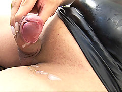 Busty shemale babe peels off her tight latex