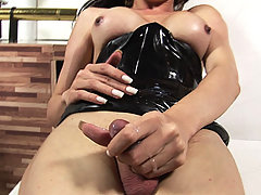 Big cock brunette shemale strips and teases in latex