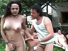Trannies n guy have orgy outdoors
