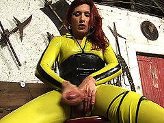 Latex clad shemale strokes her cock